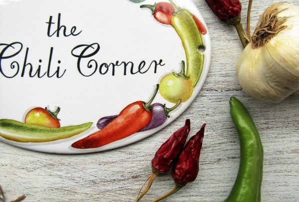 detail of chili peppers personalized kitchen signs