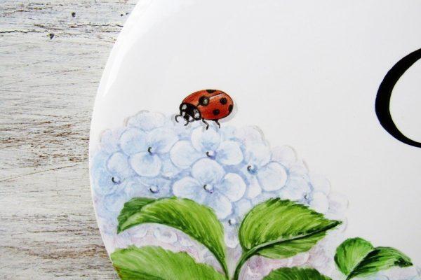 ladybug detail on hydrangea sign