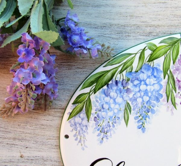 detail of wisteria branches on personalized sign
