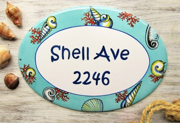Personalized street address sign with shells decoration