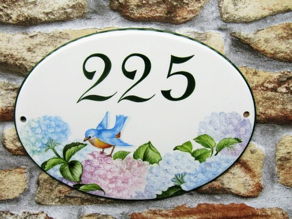 Little Bird House Number Plaque on wall